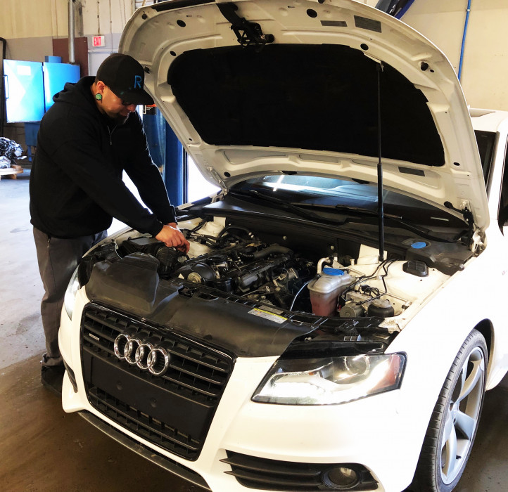 Robert - German vehicle specialist, putting the finishing touches on a customer Audi.