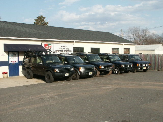 Land Rovers at the shop.