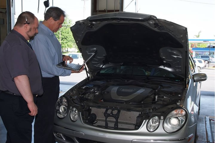 Owner Evan Brodof inspects a customers car