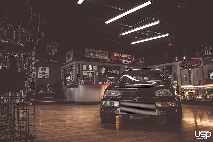 Full showroom featuring our race car, customer lounge, multiple TVs, and more!